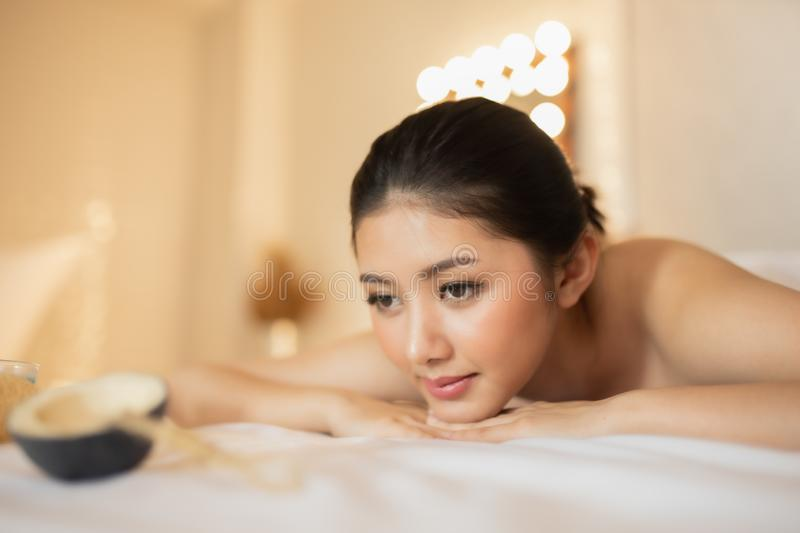 Asian Beautiful, young and healthy woman in spa salon. Massage treatment spa room  . Traditional medicine and healing concept stock photo