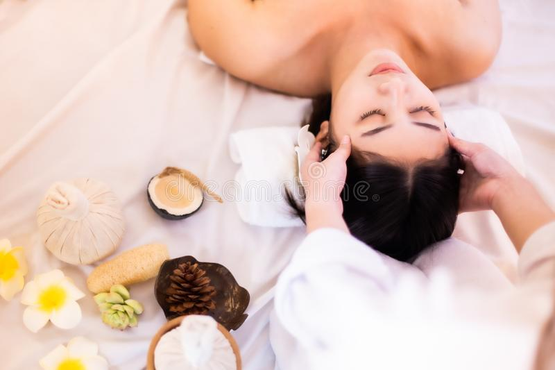 Asian Beautiful, young and healthy woman in spa salon. Massage treatment spa room  . Traditional medicine and healing concept royalty free stock images