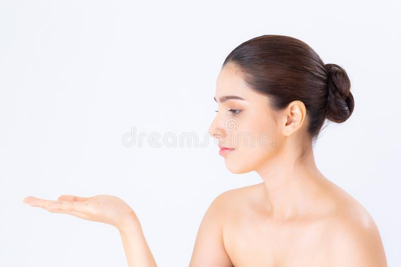 Asian beautiful young woman showing with healthy clean skin presenting something empty copy space on the hand. On white background, beauty concept stock photography