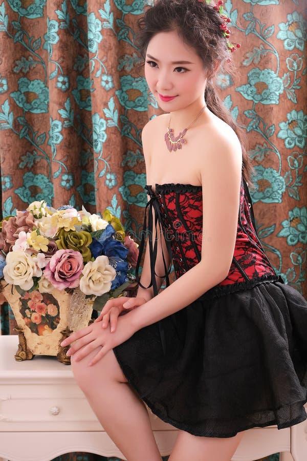 Asian beauty. Beautiful asian girl wearing corset and black skirt,show good stature stock photos