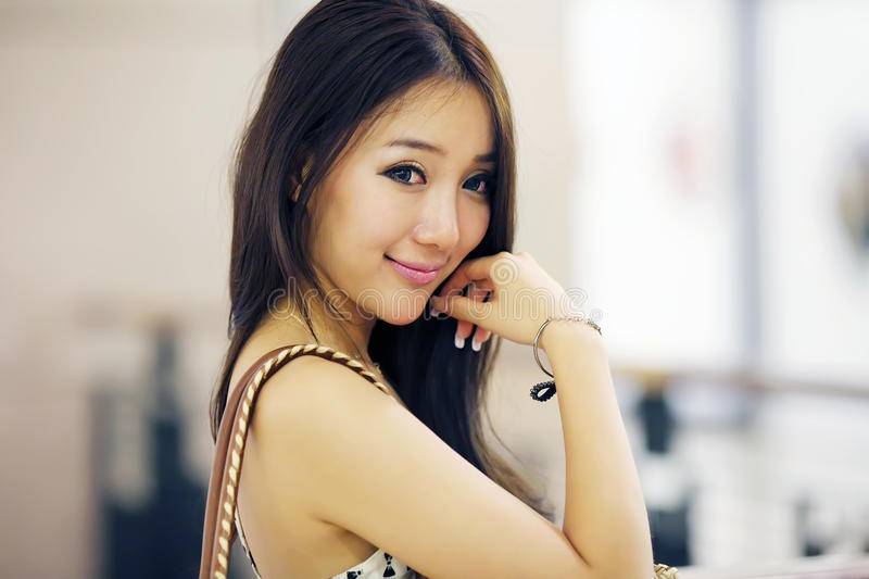 Asian beauty indoor portrait. Asian beauty smiling indoor portrait.(in a mall stock image