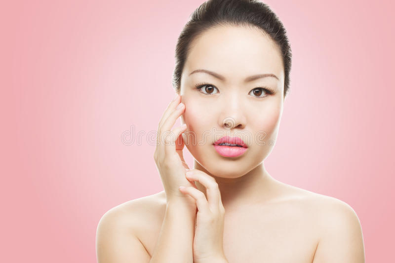 Asian beauty portrait. Asian woman beauty face closeup portrait. Beautiful attractive mixed race Chinese Asian / Caucasian female model with perfect skin royalty free stock image