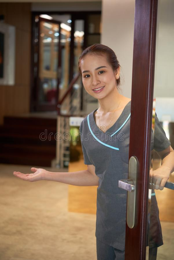 Asian beauty salon employee welcoming you royalty free stock photography
