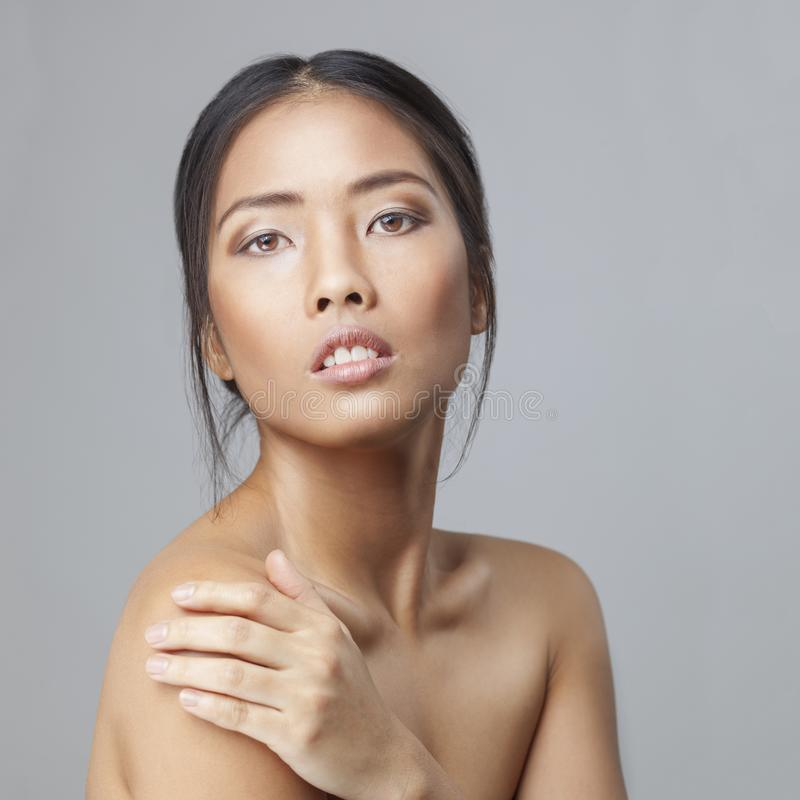 Asian beauty skincare woman touching skin on shoulder royalty free stock photography
