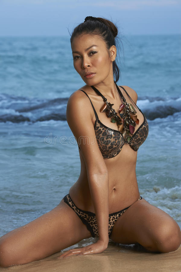 Download Asian Beauty On Sunny Beach Stock Photo - Image: 28412776