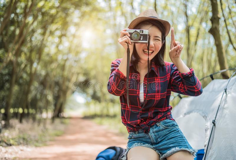 Asian beauty traveler taking photograph by digital cemera while hiking camping. Adventure and leisure activity concept. Happy life royalty free stock photography