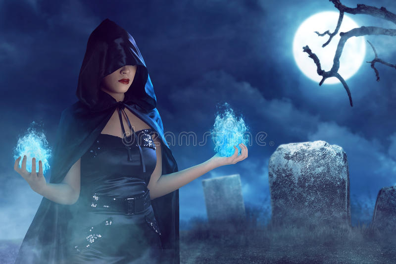 Asian beauty witch woman with blue fire on her hand. Asian witch woman with blue fire on her hand, on the cemetery and fullmoon with fog covered stock illustration