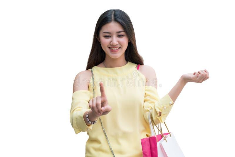 Asian beauty woman with shopping bag finger touching virtual screen stock photos