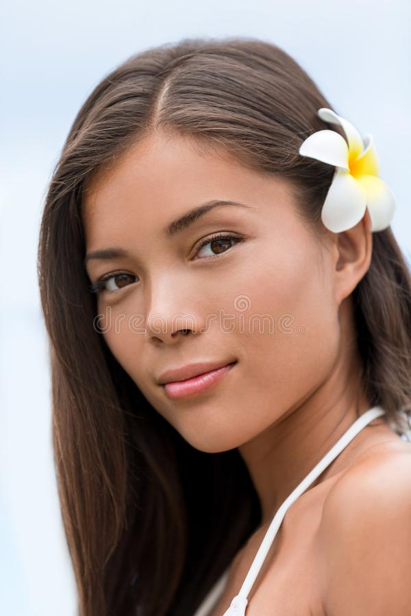Asian beauty young woman hawaiian flower portrait stock images