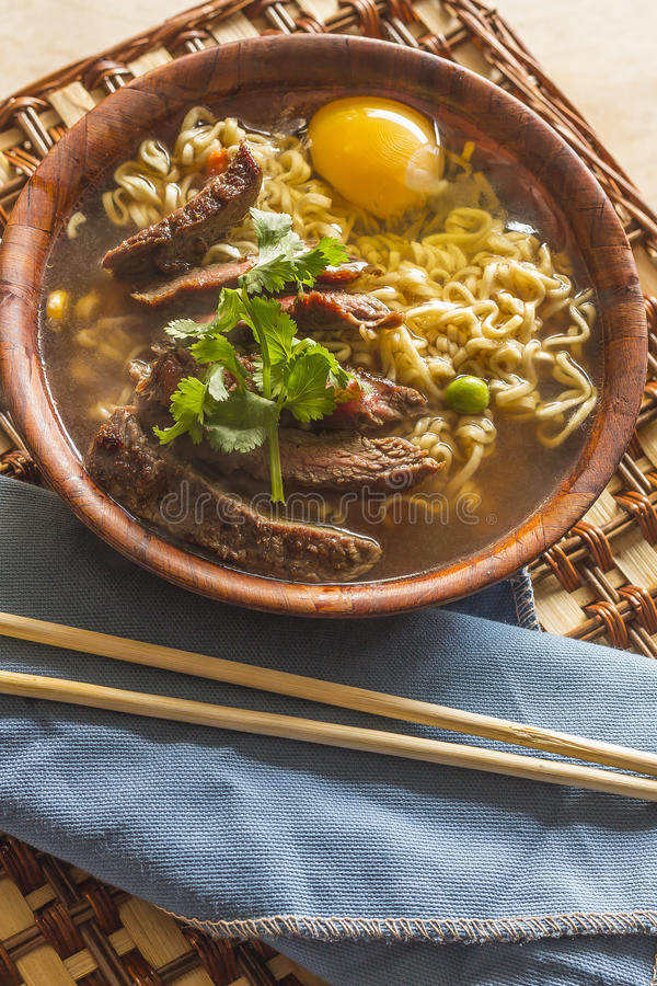 Asian Beef Ramen. Beef ramen served Asian style. Raw egg cooks in steaming hot savory broth stock images