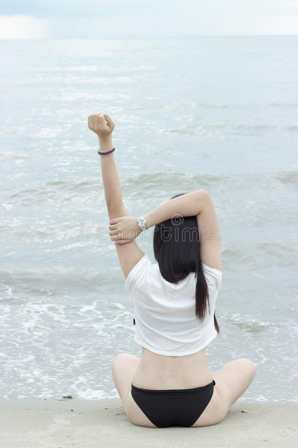 Asian Bikini Model poses at beach royalty free stock photography