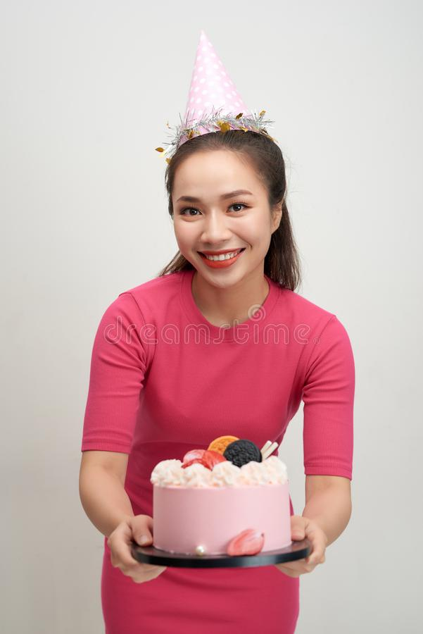 Asian birthday girl looking at camera with smile.  royalty free stock photo