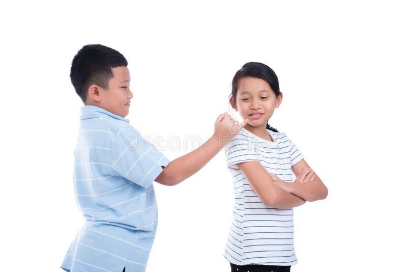Boy ask a girl to reconcile over white. Asian boy ask a girl to reconcile over white background stock photos