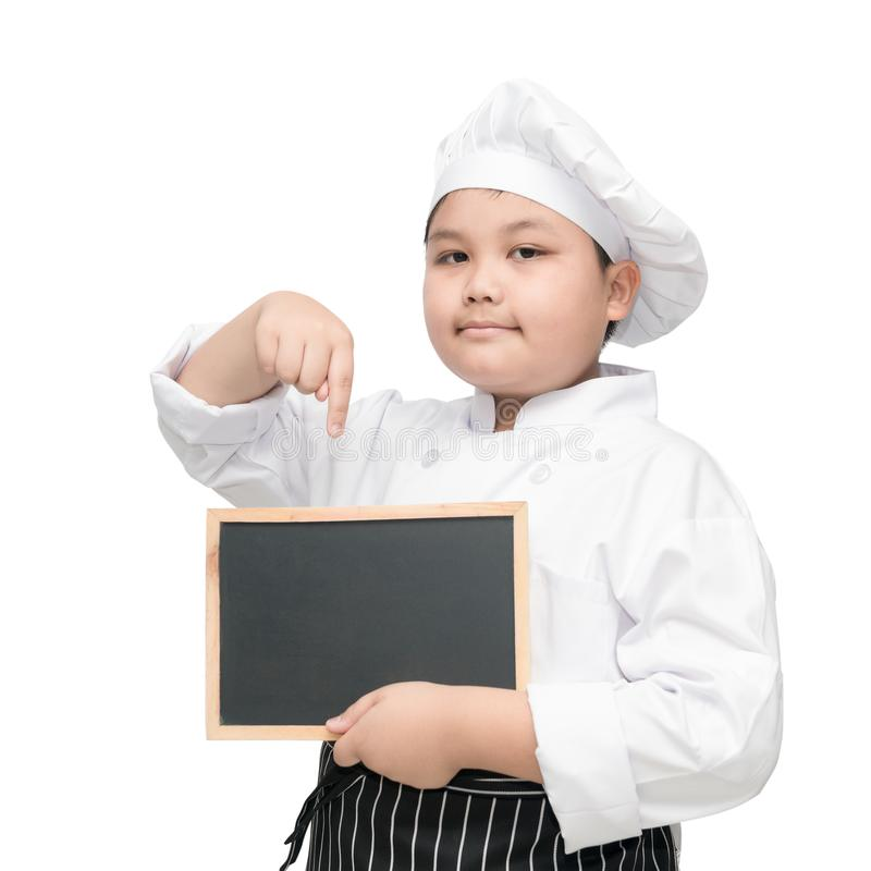 Asian boy chef in uniform cook holding blackboard stock photography