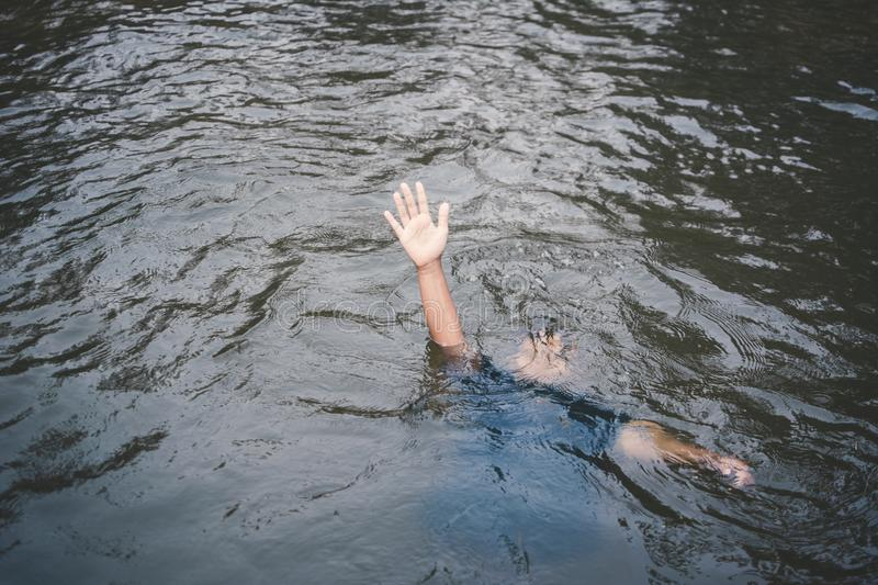 Asian boy drowning in the pool dangerous and need to help royalty free stock photos