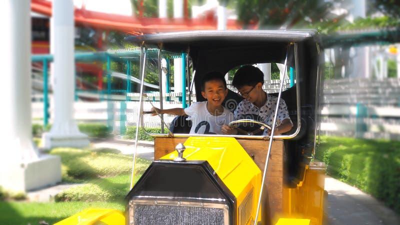 Asian boy enjoying classic car ride. selected focus. Asian boy enjoying classic car ride in a theme park royalty free stock photography