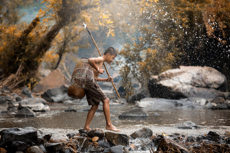 Asian boy fishing in creeks, Children fight life stock photography