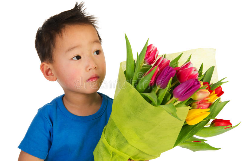 Download Asian boy with flowers stock photo. Image of isolated - 18221540