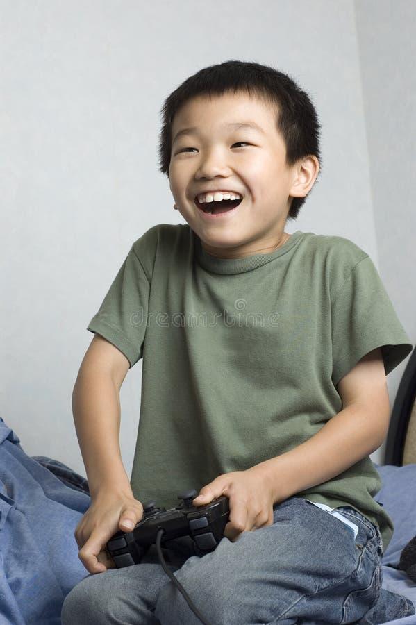Asian boy gamer royalty free stock photo