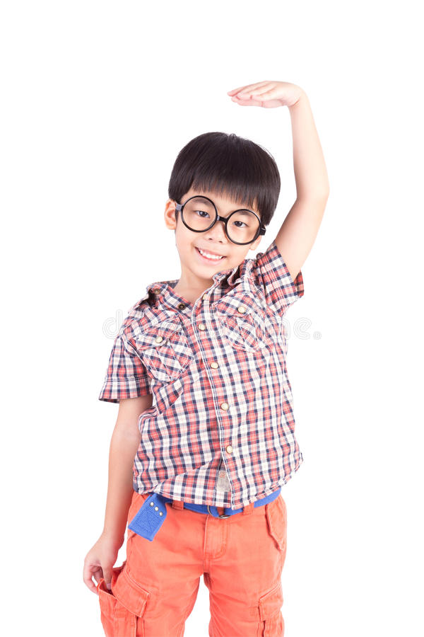 Asian boy growing tall and measuring himself. On white background stock photography