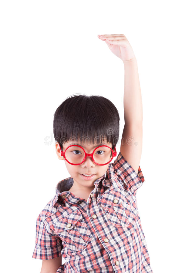 Asian boy growing tall and measuring himself. On white background royalty free stock photo