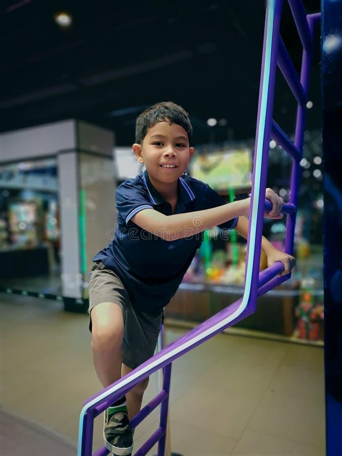 Boy Having Fun Climbing Up the Ladder royalty free stock photo