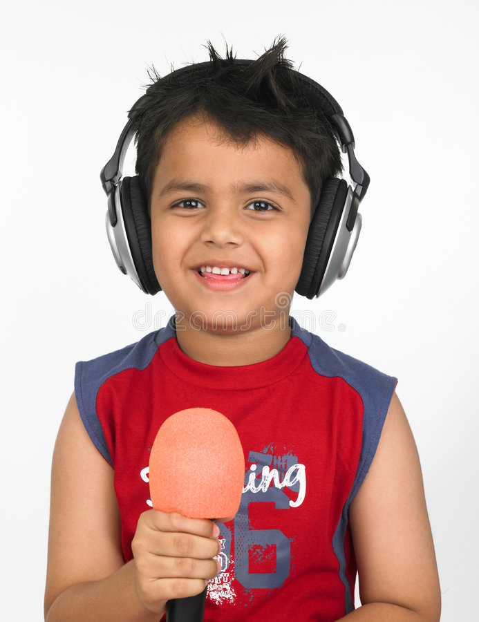 Asian boy with headphones royalty free stock photos