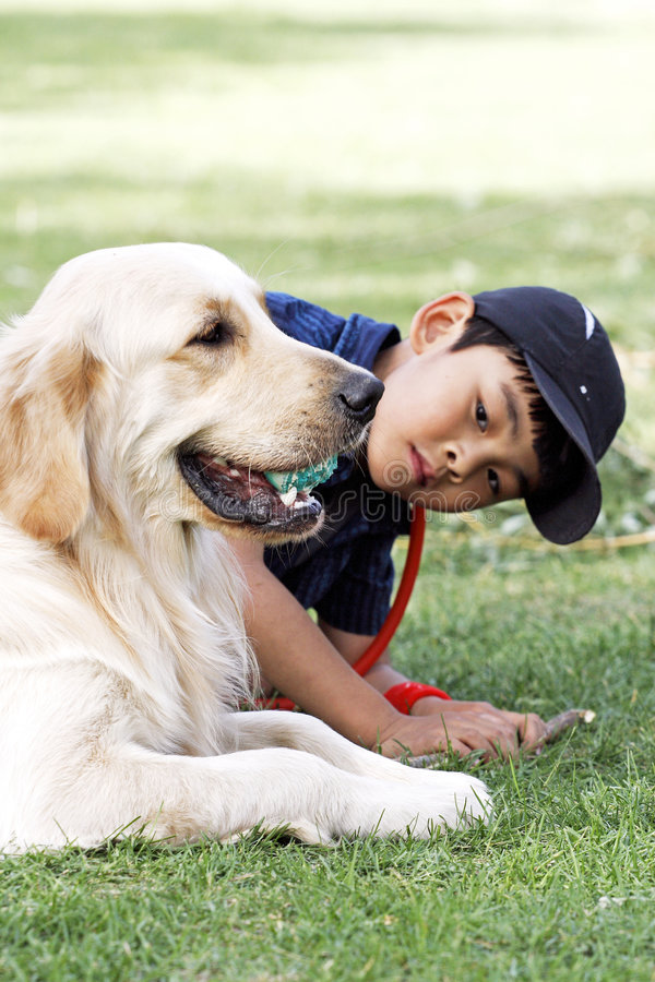 Asian boy and his dog. A Asian boy stays with his loved dog