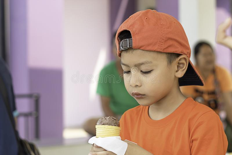 Asian boy holding the ice cream eating royalty free stock photography