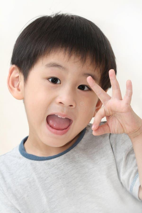 Asian boy with ok gesture stock photos