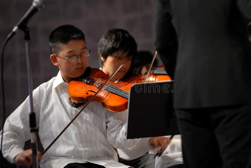 Download Asian boy play the violin editorial stock image. Image of light - 17194824