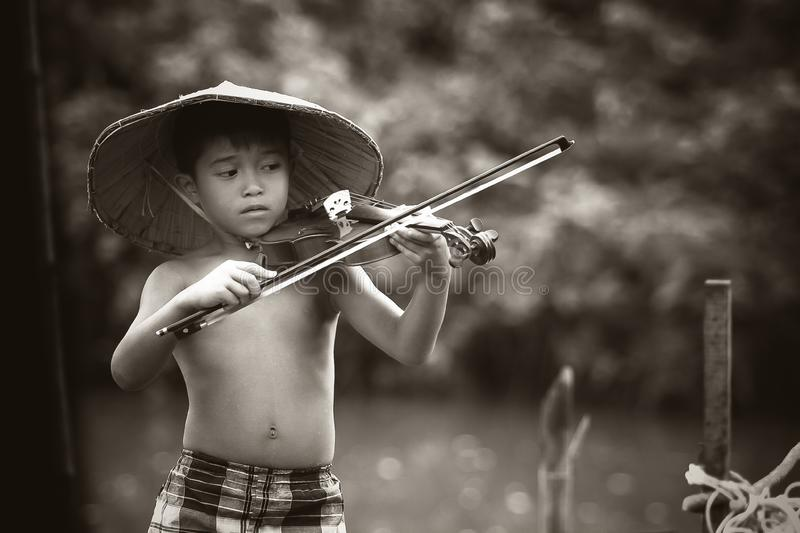 Asian boy playing violin stock images