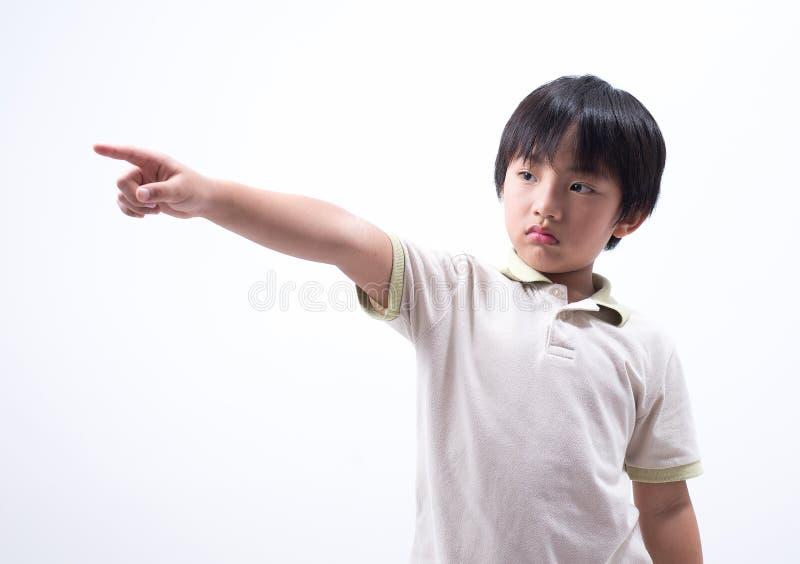 Asian boy point. Asian boy kid looking kids point finger sad sad upset portrait royalty free stock image
