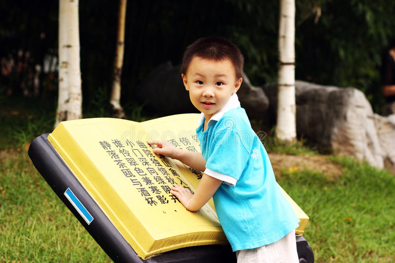 Asian boy is reading royalty free stock photo