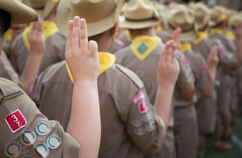 Asian boy scouts oath explained in camp activities as part of the study. stock photo