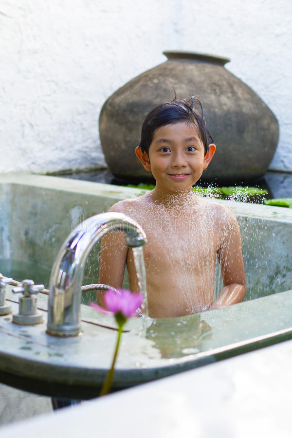 Asian boy shower royalty free stock photography