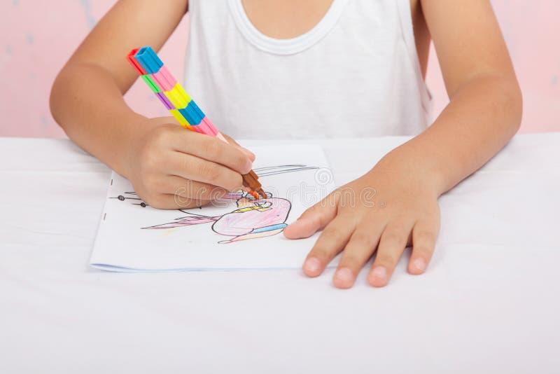 Asian boy Sitting coloring homework stock image