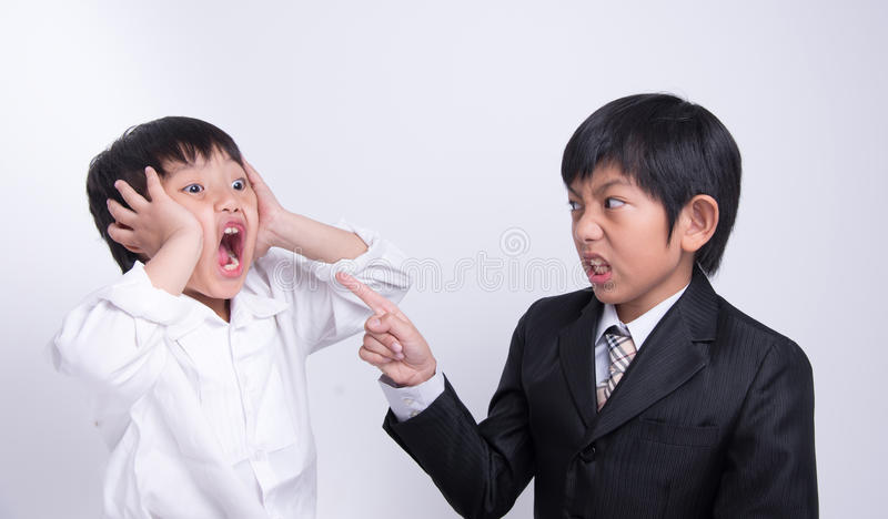 Asian boy staff boss. Businessman work complain blame point angry crazy strain stock image