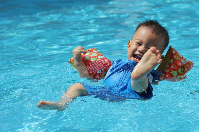 Download Asian boy swimming stock photo. Image of happy, arms - 23994550
