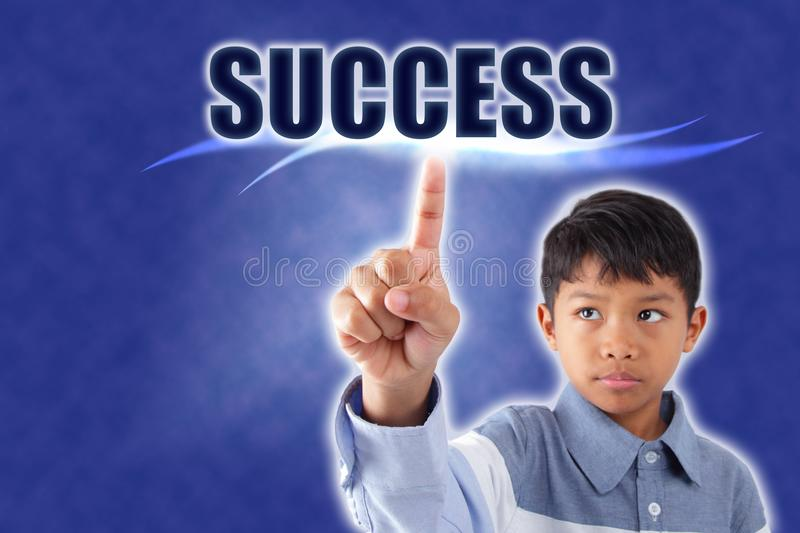 Asian boy touching success word stock photography