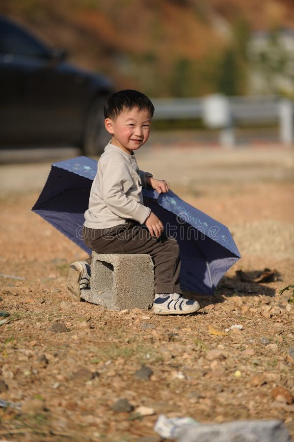 Download Asian boy and Umbrella stock photo. Image of baby, male - 13698280