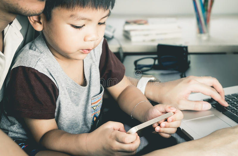 Asian boy is using Phone stock photo