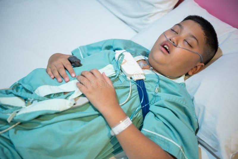 Asian boy wearing Sleep Apnea Diagnostic medical device Kit. Sleep Lab Test stock photos