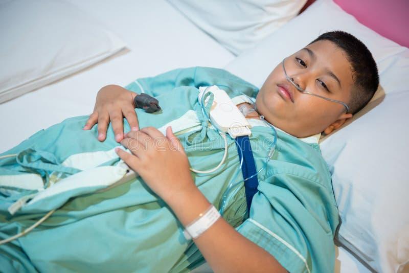 Asian boy wearing Sleep Apnea Diagnostic medical device Kit. Sleep Lab Test royalty free stock photo