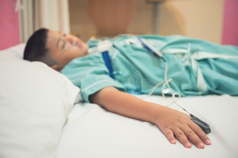 Asian boy wearing Sleep Apnea Diagnostic medical device Kit. Sleep Lab Test royalty free stock image