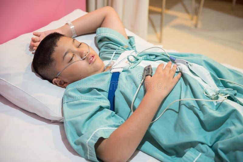 Asian boy wearing Sleep Apnea Diagnostic medical device Kit. Sleep Lab Test stock image