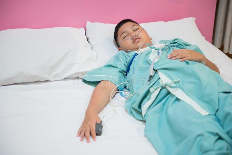 Asian boy wearing Sleep Apnea Diagnostic medical device Kit. Sleep Lab Test stock photography