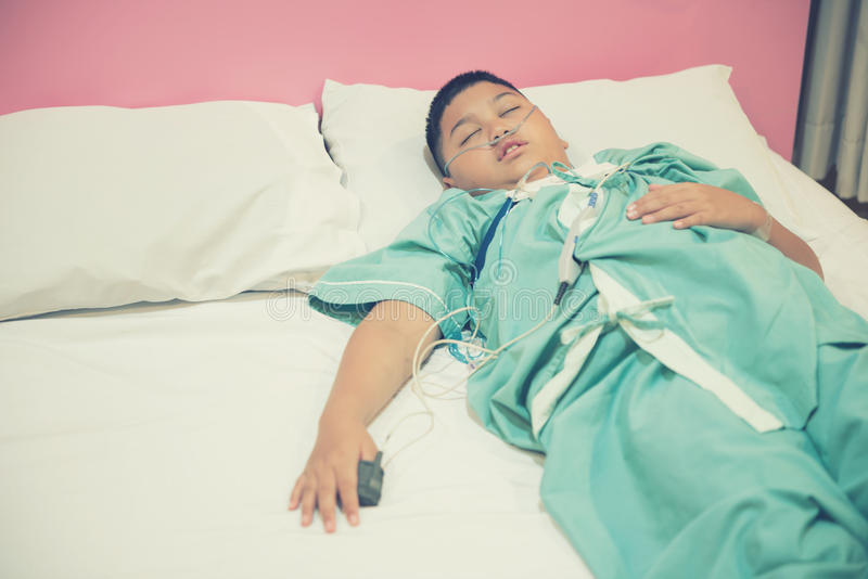Asian boy wearing Sleep Apnea Diagnostic medical device Kit. Sleep Lab Test.Vintage tone royalty free stock photo