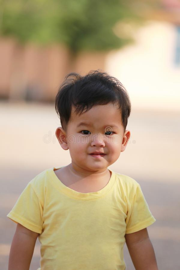 Asian boy in yellow dress and he smiled are happy. stock images