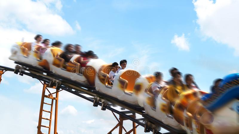 Asian boys on a roller coaster ride. selected focus. Asian boys enjoying roller coaster ride in a theme park stock images